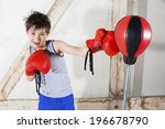 young boy with red boxing gloves | Shutterstock . vector #196678790