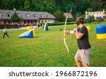 Teenage boy playing archery tag ...