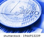 Small photo of 1 one euro coin close-up. The name of the Eurozone currency in focus. Light blue tinted background. Bright backdrop about economy and finance of the European Union. Macro