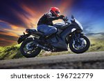 Young Man Riding Motorcycle On...