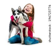 Stock photo happy little girl is with her dog husky isolated on white 196725776