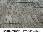 Solid wood slatted flooring on the beach to pave the access to the cabins of an establishment