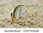 One Euro Grow On The Sand.