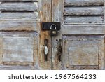 Old Wooden Door With A Rusty...