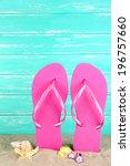 Bright Flip Flops On Sand  On...