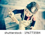happy kid playing with toy... | Shutterstock . vector #196773584