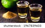 Small photo of Mezcal glasses, tequila variation with pepper salt and earthworm, traditional Mexican drink and aphrodisiac