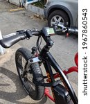 Small photo of Honolulu - March 21, 2018: Rad Power Bikes parked on red bike rack. A Seattle ebike company, Rad Power Bikes is a consumer direct ebike company making the RadRover electric fat bike.