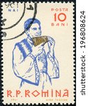 Small photo of ROMANIA-CIRCA 1961:A stamp printed in ROMANIA shows image of The pan flute or pan pipe is an ancient musical instrument based on the principle of the closed tube, circa 1961.