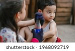 young asian sibling on red... | Shutterstock . vector #1968092719
