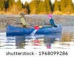 Seniors Rowing Canoe In Early...