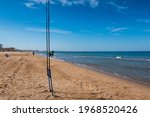 Fishing Rods On A Beach With...