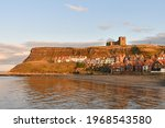 Whitby Harbour With The Church...