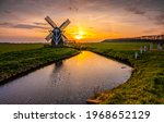 Windmill At Sunset River...