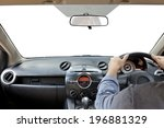Hands on the steering wheel isolated on a white