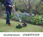 Old lawnmower being used in the ...