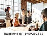 people brainstorming in a... | Shutterstock . vector #1969292566