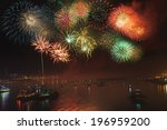 A Fireworks Display Over A Bay...