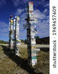 Small photo of Watson Lake, Yukon, Canada - August 7 2016: The Sign Post Forest is most popular attraction in Watson Lake on the Alaska Highway