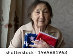 Very Old Woman With Flag Of...
