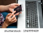 hands with cell phone in front... | Shutterstock . vector #196999409