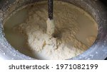 Small photo of Churning butter with buttermilk in churn, extracting of Ghee from curd.