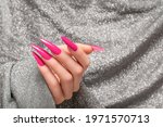 Female Hand With Pink Stiletto...