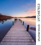 Sunset At A Wooden Jetty On...