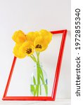 A Bouquet Of Yellow Tulips In A ...