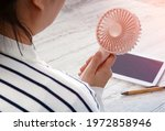 young asian woman with portable ... | Shutterstock . vector #1972858946