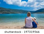 young woman sitting with son on ... | Shutterstock . vector #197319566