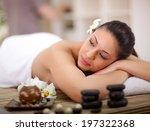 young beautiful woman in spa... | Shutterstock . vector #197322368