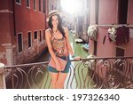 stylish girl in a straw hat on... | Shutterstock . vector #197326340