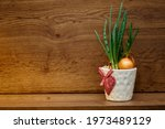 Green onion in a white pot with ...