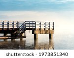 Jetty On A Lake With Fog....