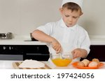 Young Boy In A Chefs Toque And...