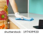 Woman Wearing Apron Cleaning...