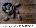 Nutmeg Placed In Wooden Bowl...