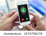 Small photo of Incoming call with unknown number or caller ID on mobile phone