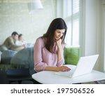 young businesswoman using... | Shutterstock . vector #197506526