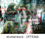 Graffiti on John Lennon wall in Prague, Czexh Republic. Famous touristic place. - stock photo