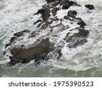 Waves Crashing Over A Rock...