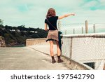 a young woman is standing on... | Shutterstock . vector #197542790