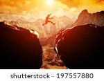 man jumping over precipice... | Shutterstock . vector #197557880