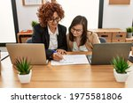 group of two women working at... | Shutterstock . vector #1975581806