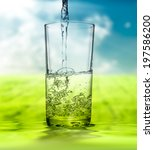 water pouring into glass on ... | Shutterstock . vector #197586200