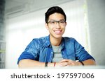 young cheerful asian man... | Shutterstock . vector #197597006