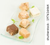 Baklava - Middle Eastern sweet pastry and nuts selection on a pale green background. - stock photo