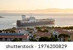 A Cargo Ship Cruising At Sunset....