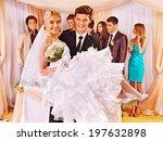 groom  carries bride on his... | Shutterstock . vector #197632898